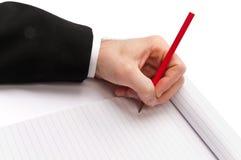 Schreiben mit einem Bleistift Stockfotografie
