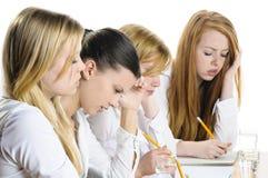 Schreiben mit vier Mädchen Lizenzfreie Stockbilder