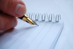Schreiben Sie auf Notizbuch Stockfoto