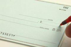 Schreiben Sie den Check Lizenzfreies Stockfoto