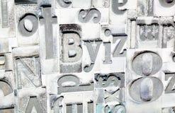 Schreiben Sie Druckmaschine gesetzte veraltete Typografie Stockfotos
