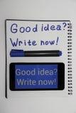 Schreiben Sie jetzt gute Idee Stockbild