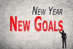 Schreiben Sie Wörter auf Wand, neues Jahr-neue Ziele Lizenzfreie Stockfotografie