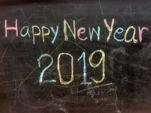 Schreibens-guten Rutsch ins Neue Jahr auf Tafel lizenzfreies stockbild