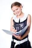 Schreibens-Schulmädchen Lizenzfreie Stockbilder