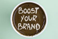 Schreibensanmerkungs-Vertretung Auftrieb Ihre Marke Die Geschäftsfotopräsentation verbessern Ihren Modellnamen in Ihrem Feld über stockfotografie