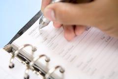 Schreibenskontaktname in der Tagesordnung Lizenzfreie Stockbilder
