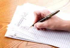 Schreibenslebensmittelgeschäftliste Stockbilder