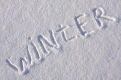 Schreibenstext auf dem Schnee Stockbild
