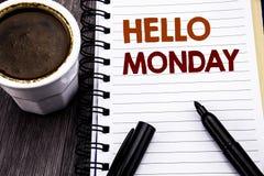 Schreibenstext, der hallo Montag zeigt Geschäftskonzept für den Tageswochen-Anfang geschrieben auf Notizbuchbuchbriefpapier auf d stockfoto