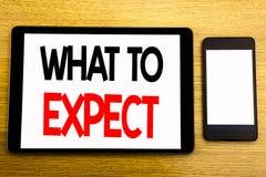 Schreibenstextvertretung zu erwarten was Geschäftskonzept für Achieve Erwartung geschrieben auf Tablettenlaptop, hölzerner Hinter Stockbild