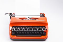Typewriter isolated on white. Image shows a nostalgic typewriter isolated on white royalty free stock images