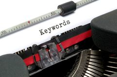 Schreibmaschinen-Schlüsselwörter Stockbild