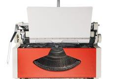 Schreibmaschinenorange auf einem weißen Hintergrund oben Stockbild