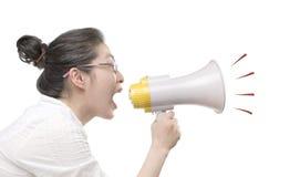 Schreien durch Lautsprecher Stockfoto