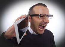 Schreien im Telefon Stockfotos