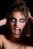 Schreiende furchtsame Frau Stockbild