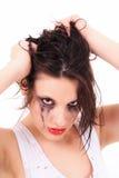 Schreiende junge Frau mit geflossener Wimperntusche Stockbild
