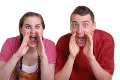 Schreiende Paare eine Ansage lizenzfreie stockfotografie