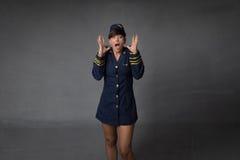 Schreiende Stewardess stockfotos