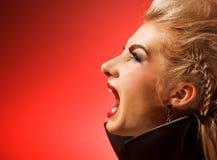 Schreiende vamp Frau Stockbild