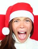 Schreiende Weihnachtsfrau mit Druck Stockbilder