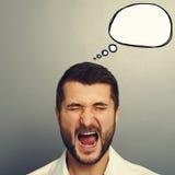 Schreiender Mann mit spech Blase Stockfotografie