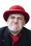 Schreiender trauriger Mann im roten Hut Stockfotografie