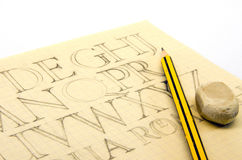 Schrift0310b. Picture of an old sheet with latin letters, pencil and eraser stock image