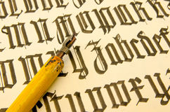 Schrift0210a. Picture of an old sheet with latin letters and pen royalty free stock photos