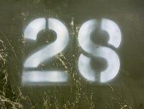 Schriftliche Benennung in beunruhigtem Zustand Typografie gefundene Nr. 28 achtundzwanzig Stockbild