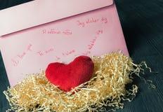 Schriftliche Liebeserklärung und Herz Stockfotos