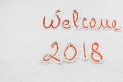 Schriftliches ` Willkommen ` 2018 auf dem Schnee Stockfotos