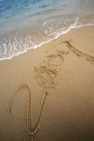 Schrijf 2009 op strand Royalty-vrije Stock Afbeelding