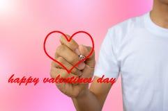Schrijf gelukkige valentijnskaartendag - het portret van mensen in wit vest schrijft royalty-vrije stock fotografie