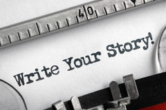 Schrijf uw die verhaal op schrijfmachine wordt geschreven Stock Afbeeldingen