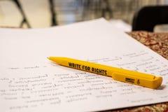 Schrijf voor Rechten, grootste rechten van de mensgebeurtenis van Amnesty International stock foto