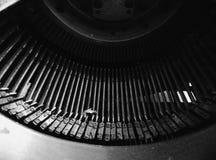 Schrijfmachine zwarte brieven Stock Foto's