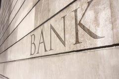 Schrijven van de bank gesneden op een steenmuur Royalty-vrije Stock Foto