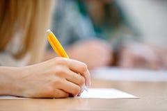 Schrijvende hand stock afbeelding