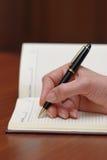Schrijvende hand Stock Afbeeldingen