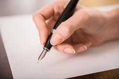 Schrijvende hand Stock Foto's