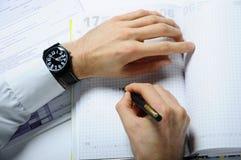 Schrijvende handen Stock Foto's