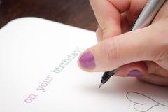 Schrijvende verjaardagskaart Stock Foto