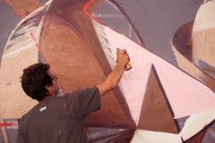 Schrijver aan het werk met aërosols bij Overline-de gebeurtenis van de Jamhiphop Royalty-vrije Stock Afbeeldingen