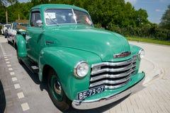 Schrijver uit de klassieke oudheid 1950 Chevrolet 3100 oogstvrachtwagen Royalty-vrije Stock Foto's