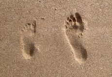 Schritt auf dem Sand Stockbilder