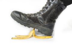 Schritt auf einer Bananenschale Stockfoto