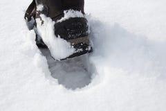 Schritt im Schnee Lizenzfreie Stockfotos