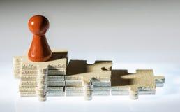 Schritte gemacht von hölzernen Puzzlespiel partes Stockbild